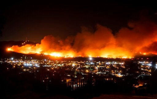 (AP Photo/Noah Berger, File). FILE - In this Oct. 31, 2019, file photo, smoke from the Maria Fire billows above Santa Paula, Calif. The nation's largest utility says its distribution lines have sparked no damaging wildfires since it began repeatedly sh...
