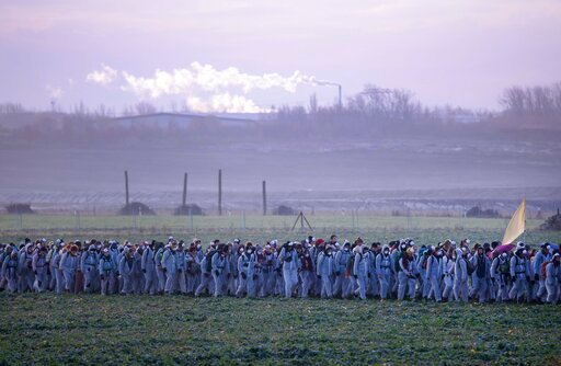 (AP Photo/Jens Meyer). Supporters of the climate movement Ende Gelaende protest in front of a coal-fired power station Lippendorf near Leipzig, Germany, Sunday, Nov. 24, 2019. Ende Gelaende is an action alliance for an immediate coal exit, climate just...