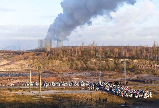 (AP Photo/Jens Meyer). Supporters of the climate movement Ende Gelaende protest at the coal-fired power station Lippendorf near Leipzig, Germany, Sunday, Nov. 24, 2019. Ende Gelaende is an action alliance for an immediate coal exit, climate justice and...