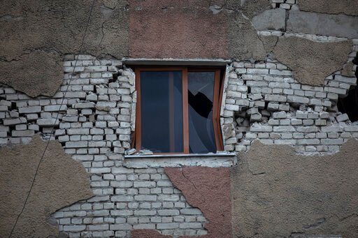 (AP Photo/Petros Giannakouris). In this Wednesday, Nov. 27, 2019 photo, the broken window of a damaged building in Thumane, western Albania following a deadly earthquake. The 6.4-magnitude quake that hit Albania's Adriatic coast before dawn on Tuesday ...