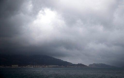 (AP Photo/Daniel Cole). Rain clouds form over Marseille, France, Sunday, Dec. 1, 2019. The southern France region is under alert for heavy rain and floods.