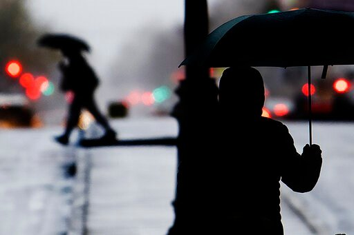 (Jose F. Moreno/The Philadelphia Inquirer via AP). Pedestrians shield from the rain with an umbrellas during a cold rainy day in Center City, Sunday, Dec. 1, 2019 in Philadelphia.
