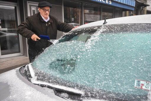 (Jacqueline Dormer/Republican-Herald via AP). Paul Ciotti, of Minersville, Pa., scrapes ice off of his car windshield parked along Sunbury Street in Minersville, Pa., on Sunday, Dec. 1, 2019.