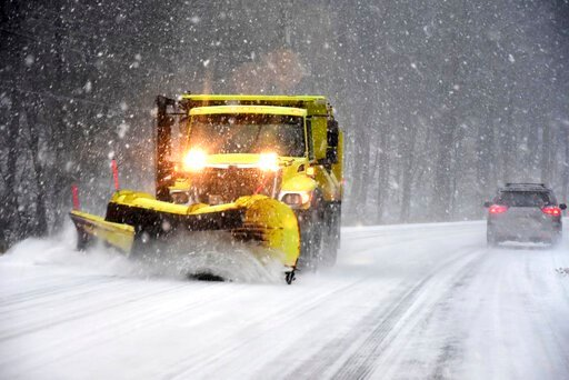 (GIllian Jones/The Berkshire Eagle via AP). A snow plow clears the road surface on Route 7, Sunday, Dec. 1, 2019 in New Ashford, Mass. A powerful winter storm that's been tormenting travelers across the U.S. since before Thanksgiving moved to the North...