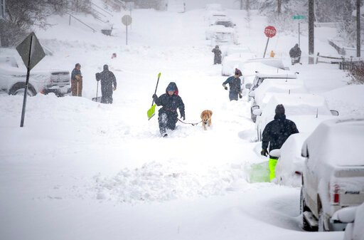 (Alex Kormann/Star Tribune via AP). Neighbors work together in an effort to clear out as much snow as possible from E. 8th Street, Sunday, Dec. 1, 2019, in Duluth, Minn.
