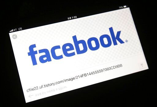 (AP Photo/Ahn Young-joon). FILE - In this Wednesday, March 21, 2018 file photo, the Facebook logo is seen on a smartphone in Ilsan, South Korea. Facebook has started testing a tool that lets users move their images more easily to other online services,...