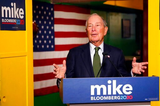 (AP Photo/Rick Scuteri, File). FILE - In this Nov. 26, 2019, file photo, Democratic presidential candidate Michael Bloomberg speaks to the media in Phoenix. Democrats are narrowing Donald Trump's early spending advantage, with two billionaire White Hou...