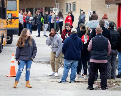 (Rick Wood/Milwaukee Journal-Sentinel via AP). Waukesha South High School students find their waiting parents and friends and hug after they leave the building following shots fired inside the school, Monday, December 2, 2019. A  suspect is in custody ...