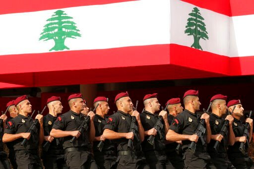 (AP Photo/Hassan Ammar). Lebanese marine special forces soldiers march during a military parade to mark the 76th anniversary of Lebanon's independence from France at the Lebanese Defense Ministry, in Yarzeh near Beirut, Lebanon, Friday, Nov. 22, 2019. ...