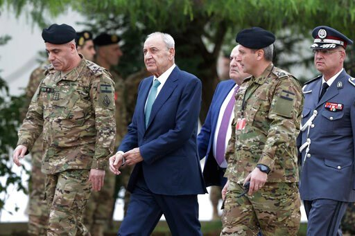 (AP Photo/Hassan Ammar). Lebanese Parliament Speaker Nabih Berri, center, arrives to attend a military parade to mark the 76th anniversary of Lebanon's independence from France at the Lebanese Defense Ministry, in Yarzeh near Beirut, Lebanon, Friday, N...