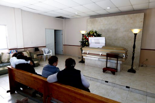 (AP Photo/Eduardo Verdugo). Family and friends attend the wake of a person who died during a gunbattle in Villa Union, Mexico, Monday, Dec. 2, 2019. The small town near the U.S.-Mexico border began cleaning up Monday even as fear persisted after 22 peo...