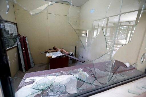 (AP Photo/Eduardo Verdugo). Windows are broken at City Hall after a gunbattle in Villa Union, Mexico, Monday, Dec. 2, 2019. The small town near the U.S.-Mexico border began cleaning up Monday even as fear persisted after 22 people were killed in a week...