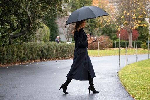 (AP Photo/Alex Brandon). First lady Melania Trump walks on the South Lawn of the White House before departing with President Donald Trump as they head to England, Monday, Dec. 2, 2019, in Washington.