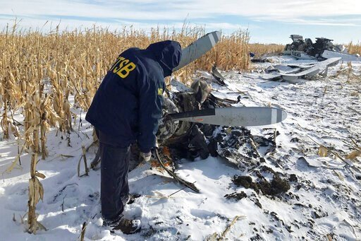 (NTSB via AP). In this Monday, Dec. 2, 2019, photo provided by the National Transportation Safety Board (NTSB), an NTSB air safety investigator begins the initial examination of the wreckage of the Pilatus PC-12 that crashed in Chamberlain, S.D., on No...