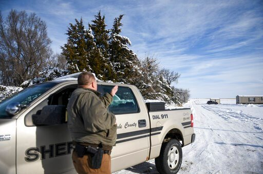 (Abigail Dollins/The Argus Leader via AP). Lester Plank, a deputy with the Brule County Sheriff's Department, looks in the direction of a plane crash on Monday, Dec. 2, 2019 in Chamberlain, S.D. Nine people were killed and three people were injured in ...
