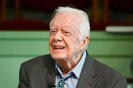 (AP Photo/John Amis, File). FILE - In this Nov. 3, 2019 file photo, former President Jimmy Carter teaches Sunday school at Maranatha Baptist Church in Plains, Ga.   Carter was released from Emory University Hospital on Wednesday, Nov. 27,  after recove...