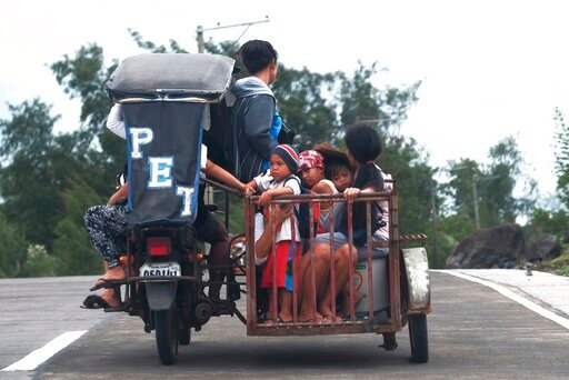 (AP Photo). Residents ride a pedicab as they evacuate to higher grounds in preparation for the coming of Typhoon Kammuri in Legazpi, Albay province, southeast of Manila, Philippines on Monday Dec. 2, 2109. The Philippines' main island, including the na...