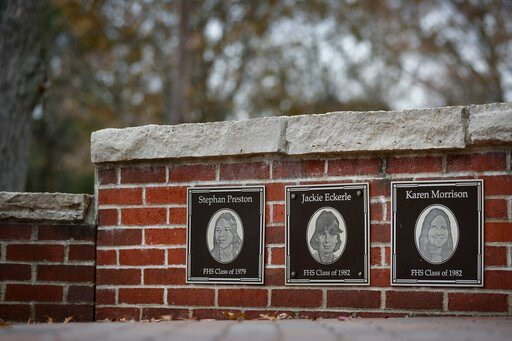(AP Photo/John Minchillo). In this Thursday, Nov. 21, 2019 photo, the faces of the three Finneytown students killed in a stampede at The Who's Dec. 3, 1979 concert, are displayed as part of a memorial at the Finneytown High School secondary campus in F...