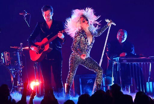 "(Photo by Matt Sayles/Invision/AP, File). FILE - This Feb. 10, 2019 file photo shows Lady Gaga, right, and Mark Ronson performing ""Shallow"" at the 61st annual Grammy Awards in Los Angeles. Lady Gaga will perform at AT&T TV Super Saturday Night in M..."