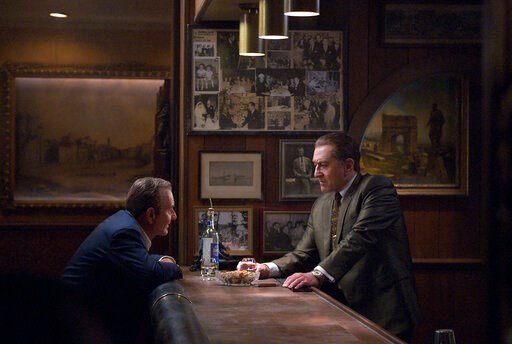 "(Niko Tavernise/Netflix via AP). This image released by Netflix shows Joe Pesci, left, and Robert De Niro in a scene from ""The Irishman."" Scorsese's sprawling crime epic ""The Irishman"" has been named best picture by the National Board of Review. The aw..."