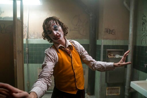 "(Niko Tavernise/Warner Bros. Pictures via AP). This image released by Warner Bros. Pictures shows Joaquin Phoenix in a scene from ""Joker.""  The film was named one of the American Film Institute's top 10 movies of the year."