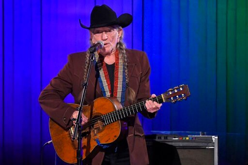 (AP Photo/Mark J. Terrill, File). FILE - In this Nov. 13, 2019, file photo, Willie Nelson performs in Nashville, Tenn. Nelson may have given up smoking, but he hasn't stopped using marijuana. While in San Antonio last week for two performances, the 86-...