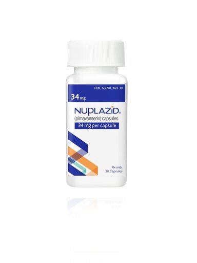 (Acadia Pharmaceuticals Inc. via AP). This undated photo provided by Acadia Pharmaceuticals Inc. shows a bottle of Nuplazid, a drug that was tested for treating psychosis related to dementia. If regulators agree, the drug could become the first treatme...