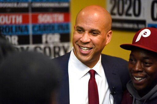 (AP Photo/Meg Kinnard). Democratic presidential contender Cory Booker poses for photos after a black men's round table on Monday, Dec. 2, 2019, in Columbia, S.C.