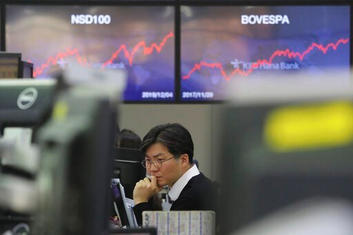 (AP Photo/Ahn Young-joon). A currency trader watches monitors at the foreign exchange dealing room of the KEB Hana Bank headquarters in Seoul, South Korea, Thursday, Dec. 5, 2019. Asian shares were rising Thursday amid renewed hopes a U.S. trade deal w...