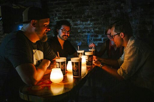 (Casey McCauley/Marvel Comics via AP). In this June 2019 photo provided by Marvel Comics, left to right, Marvel writer Skottie Young, assistant editors Danny Khazem and Kathleen Wisneski, and executive editor Nick Lowe sit inside the historic Lafitte's...