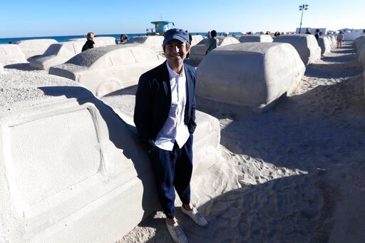 (AP Photo/Lynne Sladky). Artist Leandro Erlich, of Argentina, poses with his work featuring cars sculpted in sand stuck in a traffic jam, titled Order of Importance, displayed as part of Miami Art Week, Tuesday, Dec. 3, 2019, in Miami Beach, Fla. Erlic...