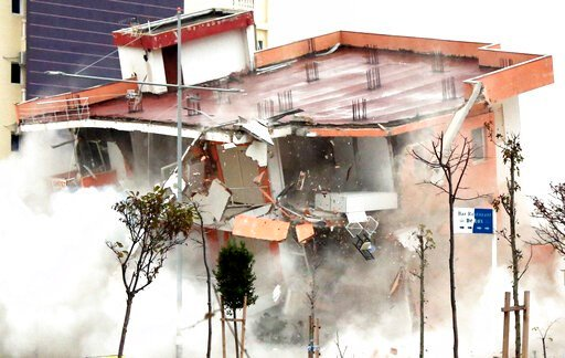 (AP Photo/Hektor Pustina). The Albanian army uses a remote-controlled explosion to demolish a building in the western port city of Durres, Albania, Tuesday, Dec. 3, 2019. A remote-controlled explosion has demolished the six-storied building considered ...