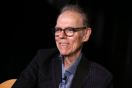 """(AP Photo/Richard Drew). This Oct. 11, 2019 photo shows singer, songwriter John Hiatt during an interview in New York to promote his box set """"Only the Song Survives,"""" available on Friday."""