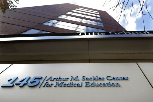 (AP Photo/Steven Senne, File). FILE - In this Sept. 25, 2019, file photo, a sign at an entrance to Tufts School of Medicine, in Boston, identifies the address as the Arthur M. Sackler Center for Medical Education. Tufts announced Thursday, Dec. 5, it w...