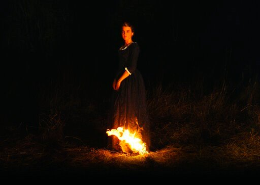"""(Neon via AP). This image released by Neon shows Adèle Haenel in a scene from """"Portrait of a Lady on Fire."""""""