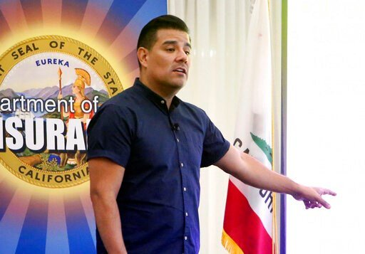 (Elias Funez/The Union via AP, File). FILE - In this Aug. 22, 2019 file photo, California State Insurance Commissioner Ricardo Lara discusses what his department is doing to help people in high wildfire risk areas keep insurance, in Grass Valley, Calif...