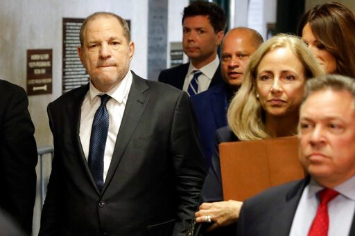 (AP Photo/Richard Drew, File). FILE - In this Thursday, July 11, 2019 file photo, Harvey Weinstein, left, arrives at court for a hearing related to his sexual assault case in New York. Harvey Weinstein is scheduled to appear in a New York City courtroo...