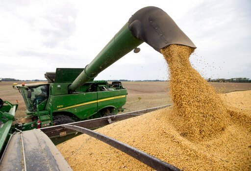 (AP Photo/Michael Conroy, File). FILE - In this Friday, Sept. 21, 2018, file photo, soybeans are offloaded from a combine during the harvest in Brownsburg, Ind. China's finance ministry Friday, Dec. 6, 2019, said Beijing is waiving tariff hikes on U.S....