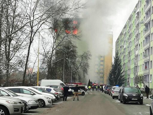 (AP Photo/Police of Slovakia/HO). A fire burns as a gas explosion severely damaged a 12th storey apartment building in Presov, Slovakia, Friday, Dec. 6, 2019. The firefighters said the explosion occurred between the ninth and 12th storey and witnesses ...