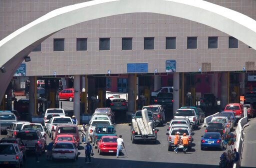 (Mark Henle/The Arizona Republic via AP, File). FILE - This June 1, 2009, file photo, shows vehicles waiting to enter the U.S. through The Dennis DeConcini Port of Entry in downtown Nogales, Ariz. For months, the U.S. has barred asylum seekers from app...