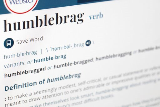 "(AP Photo/Jenny Kane). The word humblebrag is displayed on a computer screen on Friday, Dec. 6, 2019, in New York. Merriam-Webster sums up the humble-brag nicely: ""to make a seemingly modest, self-critical, or casual statement or reference that is mean..."