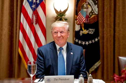(AP Photo/Andrew Harnik). President Donald Trump smiles during a luncheon with members of the United Nations Security Council in the Cabinet Room at the White House in Washington, Thursday, Dec. 5, 2019.