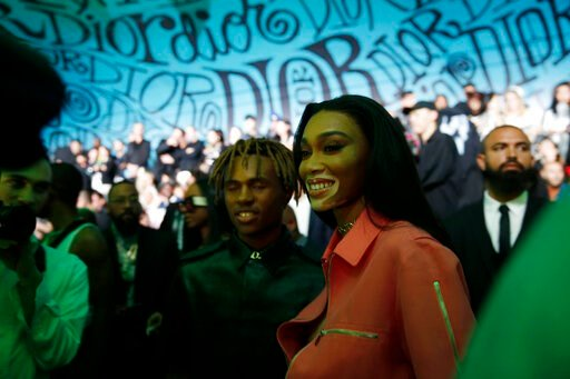 (AP Photo/Brynn Anderson). Model Winnie Harlow poses for a photograph before the Christian Dior pre-fall 2020 men's fashion collection presentation during Art Basel on Tuesday, Dec. 3, 2019, in Miami.