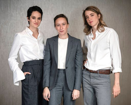 "(Photo by Christopher Smith/Invision/AP). This Sept. 30, 2019 photo shows, from left, actress Noémie Merlant, filmmaker Céline Sciamma, and actress Adèle Haenel posing for a portrait in New York to promote their film, ""Portrait of a Lady on Fire."""