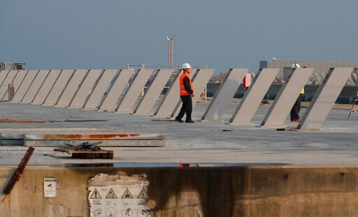 (AP Photo/Antonio Calanni). A worker stands on the construction site of the project in Venice, Italy, Friday, Nov. 29, 2019. The system of moveable under water barriers, dubbed Moses, has been beset by corruption, cost overruns and delays. Projected at...