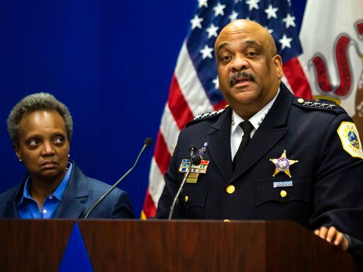(Ashlee Rezin Garcia/Chicago Sun-Times via AP). FILE - In this Thursday, Nov. 7, 2019, file photo,  Chicago Police Department Supt. Eddie Johnson, right, announces his retirement as Mayor Lori Lightfoot looks on during a press conference at CPD headqua...
