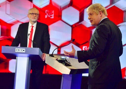 ( Jeff Overs/BBC via AP). Opposition Labour Party leader Jeremy Corbyn, left, and Britain's Prime Minister Boris Johnson, during a head to head live Election Debate at the BBC TV studios in Maidstone, England, Friday Dec. 6, 2019.  Britain's Brexit is ...