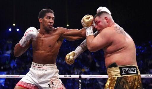 (Nick Potts/PA via AP). Defending champion Andy Ruiz Jr., right, during his fight against Britain's Anthony Joshua in their World Heavyweight Championship contest at the Diriyah Arena, Riyadh, Saudi Arabia.
