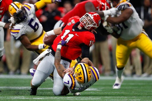 (AP Photo/John Bazemore). LSU safety Grant Delpit (7) sacks Georgia quarterback Jake Fromm (11) during the first half of the Southeastern Conference championship NCAA college football game, Saturday, Dec. 7, 2019, in Atlanta. Fromm was injured on the p...