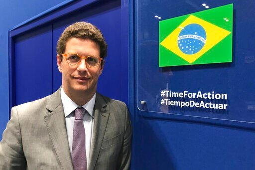 (AP Photo/Dorothee Thiesing). In this photo taken on Saturday Dec. 7, 2019, Brazilian environment Ricardo Salles stands outside the Brazil delegation room at the COP25 U.N. climate talks in Madrid, Spain. Madrid is hosting a two-week global summit aime...